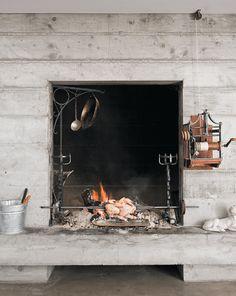 prefab-concrete-farmhouse-cypress-slab-table-salvaged-branch-crystal-chandelier-14-fireplace.jpg