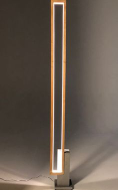 LT MIRE WOOD Floor lamp with a clear LED light strip all around the rectangular frame in Ash wood. 60 to high X 8 inch / 50 lbs. Concrete Light, Concrete Wood, Wooden Lamp, Wooden Diy, Hanging Lamp Shade, Deco Luminaire, Wood Floor Lamp, Lampe Led, Strip Lighting