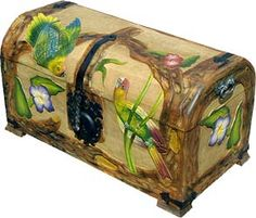 $349.00-Stow away your treasures in this treasure of a chest!  Meticulously hand-carved and hand-painted in central Mexico, this charming parrot trunk is the perfect way to infuse your home décor.  A pleasing coffer to stash your cache, you can store all of your collectibles and heirlooms...even your stockpile of sweaters! Keep it at the foot of your bed or in your favorite cozy corner, anywhere you want to add a splash of color and charm. 31W X 16D X 17H