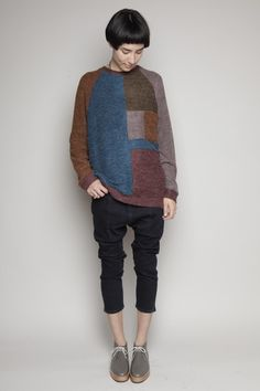 Awesome graphic baggy sweater and black capri's,