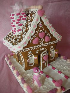 Valentine gingerbread houses - Love this one, but it' looks a bit more difficult with the curves.   I like the Good 'n Plenty idea
