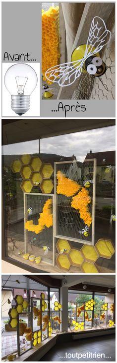 Décoration vitrines été magasin d'optique, abeilles avec des ampoules usagées www.toutpetitrien.ch - fleurysylvie