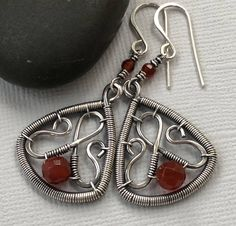 Silver Earrings/ Wire Earrings with Carnelian/ Orange Carnelian Earrings/ Artisan Earrings/ Wire Wrapped Earrings/ Carnelian Earrings by mese9 on Etsy https://www.etsy.com/ca/listing/572790671/silver-earrings-wire-earrings-with