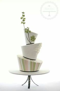 Topsy Turvy Cake with a Branch of flower topper