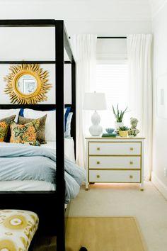 white master bedroom, gold, ikat, blue, sunburst mirror, canopy poster bed, sisal rug