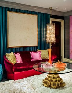 velvet red couch, teal walls, white shag rug with pink and gold accents--gorgeous!