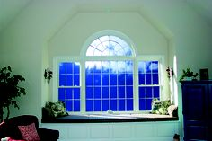 Large picture window, with decorative arched window and double hung side windows. Sliding Windows, Casement Windows, Arched Windows, Windows And Doors, Window Cleaner Recipes, Aspen House, Home Improvement Companies, Energy Efficient Windows, Side Window