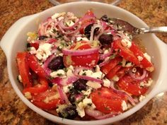 Greek Tomato Salad - a fabulous and tasty salad with Roma tomatoes, Kalamata olives, red onions, and Feta cheese in a delicious marinade that will knock your socks off!