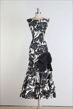 Lovely Vintage 1950s Evening Dress ♦ Henry Harris design in a black and white cotton faille print with a large, black taffeta bow on the left hip