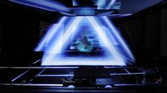 Created by aircord lab. http://www.aircord.co.jp/labo/  -- N-3D Move is a robotic display that controls multiple screens in sync with a person's movements or video.  The display's video is reflected on a screen which has a special film and half mirror attached to it, producing a holographic effect.  The screen's movement and rotation are controlled based on a DMX signal containing information on position and angle, which is sent from the system.  You can also experience a ...