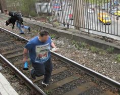 Hero saves dog after owner drags it onto railway tracks