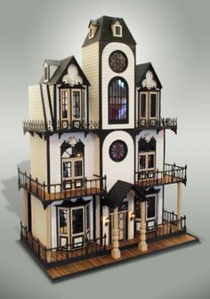 Doll house-love the brown and white, not to mention the windows and decks!