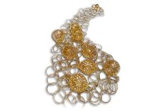 18 karat gold filigree ball and loose link necklace.