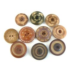 Vegetable ivory buttons  - are a natural renewable rain forest material from a palm tree also called tagua and other palm nut ,names.
