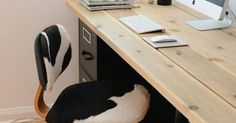 Idea about Home Office Table : 20 DIY Desks That Really Work For Your Home Office I really like the simplicity of this desk... and the mix of the wooden top and the black filing cabinet