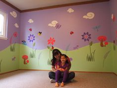 Mommy and daughter enjoying this flowery big-girl room wall mural for the first time. Wall decor by My Wonderful Walls www.mywonderfulwalls.com