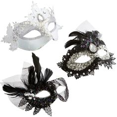 "Masquerade Masks - Inspired by winter's glistening beauty, these masks are just the excuse you need to throw a spectacular masquerade party (where, obviously, you'll be the glamorously masked star). Not into hosting quite that much of an extravaganza this year? Place a few masks on your Christmas tree, garland or incorporate one into a winter display or centerpiece. Black: 8""W x 0.25""D x 7""H White: 9""W x 0.25""D x 5""H Polyester, polypropylene beads, beads, sequins Decorative use only"