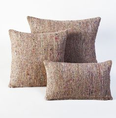 $44.99 Global Market Pillow - One of Estee's favorite styles, this wool multi-colored pillow has an organic and worldly feel that's simply irresistible. The woven wool texture and bright hues blend into the natural beige, creating the feel of woven wedge espadrilles with a safari-inspired twist.