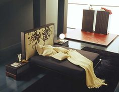 Stylish-bedroom-with-wooden-night-stands-beige-pillows-black-carpet-and-wooden-cabinets