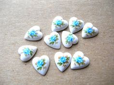 Hey, I found this really awesome Etsy listing at https://www.etsy.com/listing/227104013/vintage-blue-heart-cabochons-porcelain