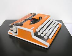 "Orange typewriter.  New red & black ribbons.  (for ""guest book""/ personalized, typed notes & wishes). $220.  https://www.etsy.com/listing/173340881/working-typewriter-unis-tbm-de-luxe-good?ref=shop_home_active_15"