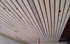 slat board ceiling | Keeping the boards straight and consistent was a challenge