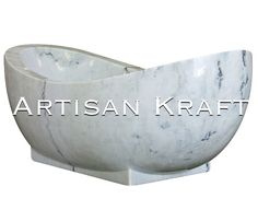 Natural marble freestanding bathtub carved from a solid block of Moon White marble. This is a freestanding double slipper bathtub with a pedestale. Artisan Kraft has a great selection of bathtubs, range hoods, sinks and fireplaces. View our great selection of stone tubs on our website.