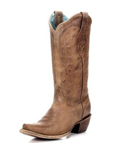 These boots are so pretty. Not too fancy but still very nice.  Corral Women's Vintage Tan Cowhide Boot