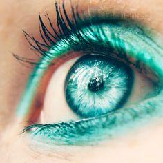 Love the aqua eye... Not the makeup