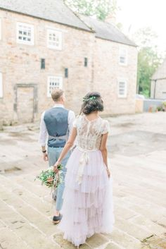 Bride Laura wore a tiered wedding dress by Katya Katya Shehurina for her peach wedding at Lartington Hall in Teesdale. Photography by Sarah Jane Ethan.