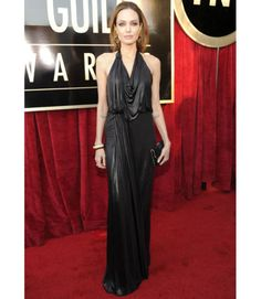 2012: Angelina Jolie wore a black Jenny Packham halter gown with a drape front paired with a Louis Vuitton black clutch. She looked gorgeous in this gown! Her earrings are gorgeous and look wonderful with the gown. It adds that glam and edge she has going on! Beautiful!