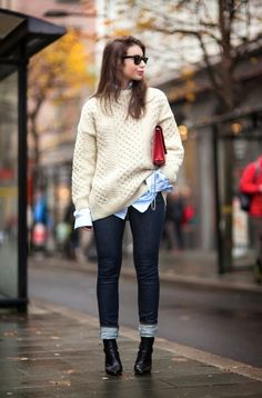 Ray-Bans, fisherman sweater, blue collared shirt, red bag, dark jeans and pointed toe boots #style #fashion