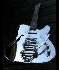 Trussart stainless electric guitar.    Really cool guitar. JUST COOL !