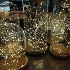 string lights in hurricane lamps   I   wonder if I would be able to recreate these. Maybe change out the lights for   various seasons?