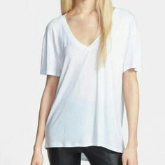 "Oversized White Soft V Neck Tee T-Shirt Oversized White Soft V Neck Tee T-Shirt. NWOT tildon brand t shirt. Super soft, comfy, loose and breezy. Fits just like a basic white tee should. 24"" long in the front, 26"" long in the back. Semi-sheer material (rayon) perfect to wear with a bathing suit, bra or tank under. Bust 36"" waist 38"" hips 42"" open to offers. Tildon Tops Tees - Short Sleeve"