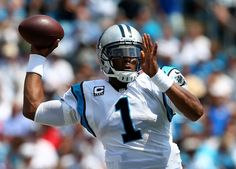 CHARLOTTE, NC - SEPTEMBER 08: Cam Newton #1 of the Carolina Panthers drops back to pass against the Seattle Seahawks during their game at Bank of America Stadium on September 8, 2013 in Charlotte, North Carolina. (Photo by Streeter Lecka/Getty Images)