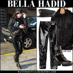 Bella Hadid in black bomber jacket, black patent pants and black platform boots