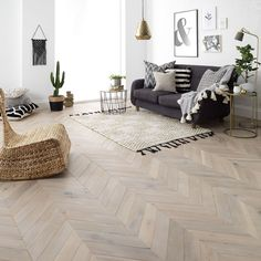 How beautiful is this chevron parquet flooring in Goodrich Haze Oak by They have a sense of the geometric, evoking the clean, interesting lines that we love in today's minimal home design. Engineered Wood, Herringbone Wood Floor, Engineered Wood Floors, Interior, Floor Design, Home, Pale Wood, Living Room Wood Floor, House And Home Magazine