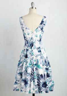 Showcase this floral dress at your most cultivated occasions, and you're sure to receive celebrity service! Outfitted with a classic bateau neckline, vertical seams, and an artistic print in deep navy, slate blue, crisp white, and rich jade hues, this lavish fit and flare is full of elegant acclaim.