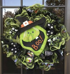 This bewitching ruffle style wreath is made of two rows and two layers of lime green and black stripe metallic, and black foil metallic deco mesh.  Mesh from http://www.trendytree.com DecoWreathbyLinda https://www.etsy.com/listing/159848934/tabitha-the-good-green-witch-light-up?ref=listing-shop-header-0 #trendytree #halloween #wreath