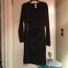 LBD cocktail/party dress NWOT. Sexy low cut dress with sinched waist and faux leather accent for a flattering look that accents your waistline. Comes right below the knee. 98% polyester, 2% spandex. Never worn. Dresses Midi
