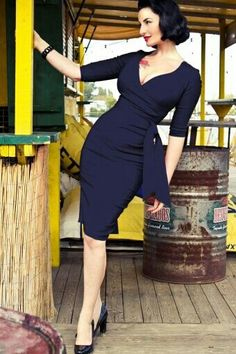 Vintage style. I've always loved a wrap-dress and this rich sapphire hue is to DIE for! (as is her teensy waist)