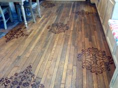 Have been debating what to do with our dining room floor.  Wanted to keep the aged look but make it unique. Big stencils and some stain is all it took. Love it now!