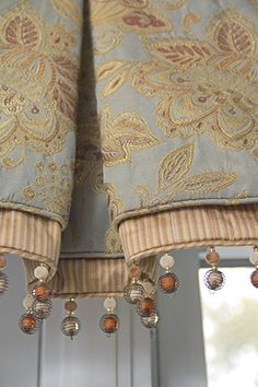 <3 What a pretty valance! I like the combination of fabrics & the trim. Tailored & custom looking.