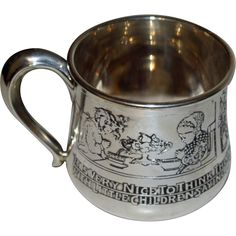 This charming sterling child's cup depicts in various scenes saying grace at meals. There are two panels, both with a girl and boy at table and about