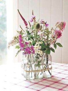DIY Vase Floral foam and glass marbles aren't the only ways to hold flowers aloft. Instead, a bunch of vintage milk bottles gives this arrangement—featured in Decorating with Flowers by Paula Pryke—its structure. Mason Jar Crafts, Mason Jars, Wild Flowers, Beautiful Flowers, Spring Flowers, Spring Bouquet, Fresh Flowers, Simple Flowers, Spring Wildflowers