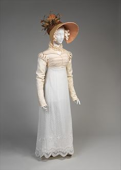 Muslin gown with whitework embroidery, spencer, and leghorn bonnet. 1814. Image @ Met Museum of Art, NYC
