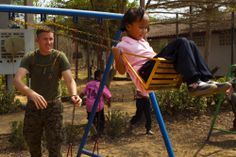 Marines take a little time out for the kids. (U.S. Marine Corps photo by Cpl. Adam Miller/Released)