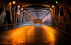I took this of the DuSable Bridge a few weeks ago in Chicago. The subterranean street levels are only a few feet down but worlds away in their appearance and feel. Undoubtably these have inspired writers, artist and uh, ...photographers. For whatever reason there were few cars going in this direction which allowed me to stand in the middle of the street to compose the shot. I kept glancing over my shoulder as I have a tendency to get engrossed when shooting which can be a little hazardous…