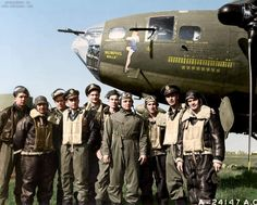 """The """"Memphis Belle"""" and crew, June 7 1943. They are, left to right: Tech. Sgt. Harold P. Loch of Green Bay, Wis., top turret gunner; Staff Sgt. Cecil H. Scott of Altoona, Penn., ball turret gunner; Tech. Sgt. Robert J, Hanson of Walla Walla, Wash.,..."""